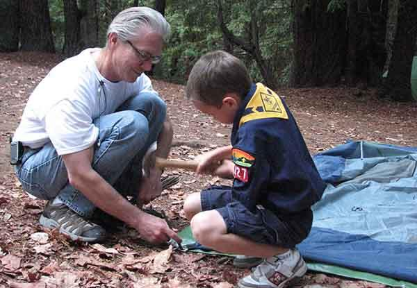 Cub Scout boy and dad setting up tent