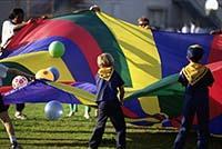 Cubs playing parachute ball