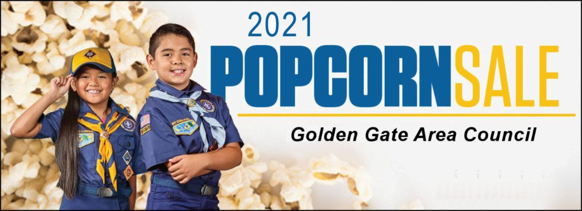 Council's annual Popcorn fund raising event showing two cub scouts with popcorn in the background.