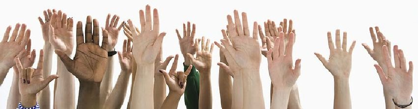 Photograph of raised hands