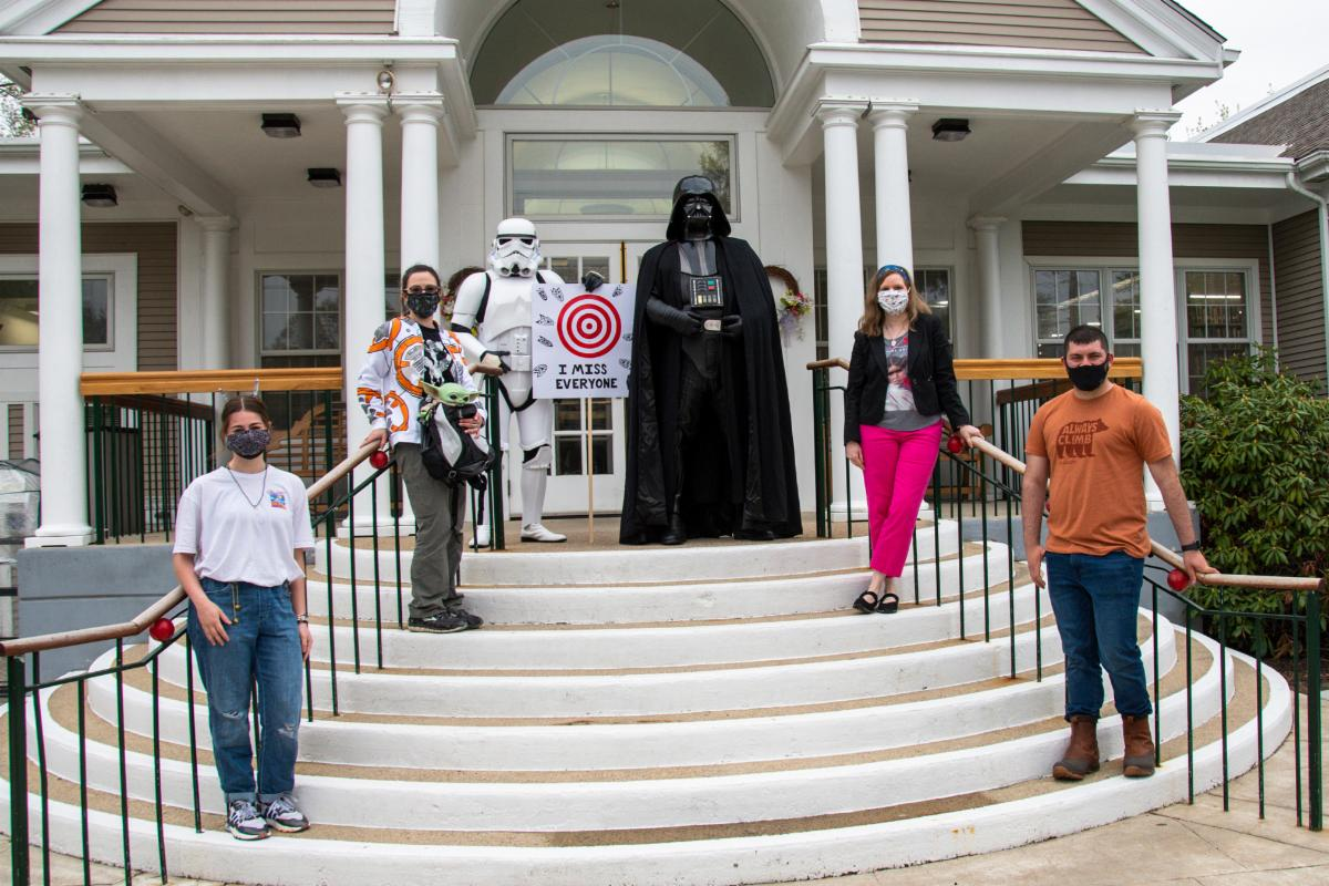Darth Vader, a Storm Trooper, and Greenville Public Library staff celebrate May the 4th