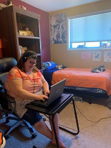 Photo - CJ engages with the SWEP program at home on her laptop.