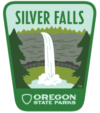 Image of Oregon State Parks logo in the shape of a badge with an image of Silver Falls.