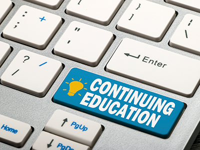 Continuing education button on computer keyboard