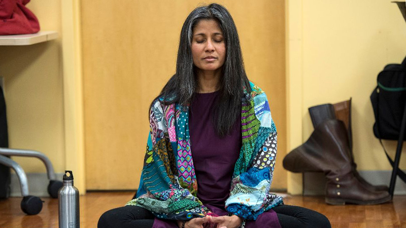 An image of a woman meditating provided by the UC Center for Integrative Health and Wellness.
